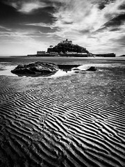 Ripples (Timothy Gilbert) Tags: rock sand wideangle gx7 panasonic mara panasonic1235mmf28x atlantic coast m43 microfourthirds blackandwhite marazion ripples beach cornwall reflection stmichaelsmount