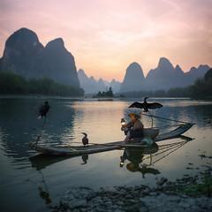 Cormorant fisherman (haelio) Tags: guilinshi guangxizhuangzuzizhiqu china cn camerasonya7r benizer lijiang river gulin xingping fisherman cormorant sunset dusk square