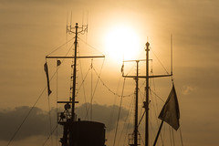 Golden Smog (life in mosquito's pit) Tags: ship mast flag sunset dusk cables lines sky clouds mood backlight orange colorful