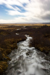 Looking down stream (Michelle Tuttle) Tags: iceland europe mountain ice snow river longexposure water flow blur clouds landscape