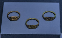 Three bronze seal rings from Tomb 8 at Via Madonna delle Grazie, Stabiae (diffendale) Tags: 6thcbce archaic necropolidiviamadonnadellegrazie castellammaredistabia antiquarium orientalizing museum museo museu muse   mze artifact display exhibit  ancient antico antique archaeological archeologico indigenous opico opici sarrasti tomb tomba grave burial human necropolis cemetery tombe tombeau spulture grab tumba sepultura bronze bronzo anelli sigillo pleiades:findspot=433128 campania