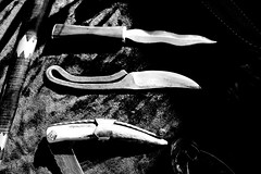Hand-Forged Blades (Jade Chanoquaway Photography) Tags: nikon nikkor d5500 cans2s fall autumn october ontario canada blackandwhite black white grey gray grayscale greyscale bw contrast light shadow monochrome silhouette shadows metal iron wood bone steel knife knives fabric outside outdoors sun sunlight sunshine tool tools texture handmade weapon weapons