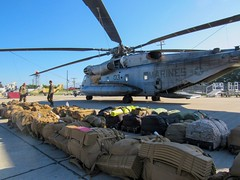 U.S. Marines with Special Purpose Marine Air-Ground Task Force  Southern Command arrive in the Cayman Islands aboard two CH-53E Super Stallion helicopters ready to support the humanitarian-aid and disaster relief effort to Haiti in response to Hurricane (Official U.S. Navy Imagery) Tags: hurricanematthew storm gtmo meteorology weather shelter evacuation navy usnavy