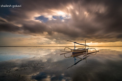 Drama at Sunrise (segokavi) Tags: bali sanur pantaikarang boat reflections sunrise nature seascape landscape motion longexposure cloudmovement