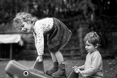 Pair of rascals (jayneboo) Tags: odc pair bw mono grandchildren roni ben fun play seesaw garden