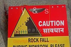 A notice board indicating Please Rock Fall During Monsoon, Caution, India (yogesh s more) Tags: city india abstract english sign danger message looking panel symbol notice board entrance plate note monsoon caution letter signpost language reminder attention information signboard limit rockfall attentive regional prohibition inform mortal marathi restriction precaution limitation notify payacom rockfallduringmonsoon