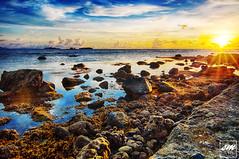 Sunset Beach (Sunny Merindo | Photography) Tags: sunset sea summer sky orange sun beach clouds rocks tali stones philippines rays batangas hdr smerindo sunnymerindo schultzpax schultpax sunnymerindoimages