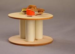 Cluster Spool - Showing streamer (Sascha Grant) Tags: orange fly model plastic cardboard laser rocket launch plywood kevlar spool lasercut scratchbuilt modelrocket oddroc scratchbuiltrocket spoolrocket oddrocket