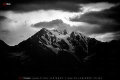 Rising in the Dark (AQAS) Tags: hunza gilgit kkh mountains clouds light landscape ancient history nature colors hill river mountainside grassland indus diran nagar valley