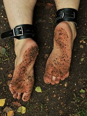 Bare feet and cuffs (Phil1503) Tags: ankle bare barefoot bdsm bondage cuffs dirty feet fetish forest ground guy male man muddy outdoors soles woodland woods outside