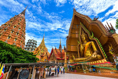Wat Tham Sua in Kanchanaburi, Thailand is a beautiful day, so it is very popular with tourists and foreigners Thailand on July 7, 2016. (Aor Chantip) Tags: southeast spirituality sua sunset skin siamese reclining religion religious sacred temple thai vacations view wat worship travel traditional thailand tiger tourism tower praying prang buddhism buddhist cave city buddha bible architecture asia attraction background famous giant oriental people pillar place orange night holiday khmer landmark monk ancient