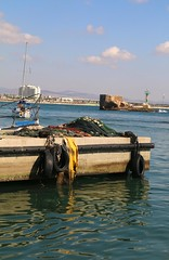 Toil at Sea (farida_kilani) Tags: sea blue akka palestine slog toil fish sun day green yellow sky fishing trawl