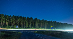 Starry Road (free3yourmind) Tags: woods forest trees stars starry night nightsky car passing light belarus