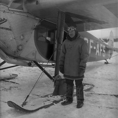 W. Griffis with Plane (TBayMuseum) Tags: pilot planes winter ontario canada history aviation aviationhistory airplanes fashion mensfashion winterclothing mukluks transportation skiplanes fokker fokkersuperuniversal