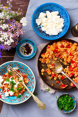 Turkish Scrambled Eggs with Tomatoes and Peppers (Zoryanchik) Tags: turkish breakfast menemen omelet pan scrambled tomato food green meal vegetable black background egg nobody horizontal cuisine pepper onion mediterranean traditional omelette