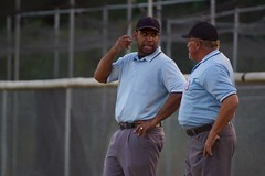 Umps, Discussing Beyonce's Latest Drop (spinadelic) Tags: sports umps umpires officials juniordeputy baseball game field timeout gray pants blue shirts conversation talk talking discuss discussion caps stevespencer fall october 2016