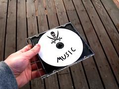Piracy music CD (Santeri Viinamaki) Tags: piracy pirate music audiodisc disc cd dvd musicpiracy copyrightinfringement piratismi piratecopy pirated piraatti pirat filesharing intellectualpiracy skullandcrossbones compactdisc antipiracy