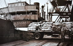 At The Docks... (colinfpickett) Tags: docks pier boat ship crane jetty trucks loading unloading daysgone