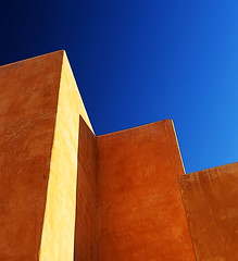 Pressing the Sky (studioferullo) Tags: abstract architecture art beauty bluesky blue sky bright light glow building buildings city classic colorful gold ochre brown orange contrast design detail downtown high house minimalism outdoor outdoors outside perspective pattern pretty serene skyline sunshine sunny sunlight street texture mercado tucson arizona line lines diagonal shadow shadows yellow