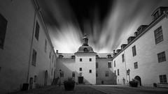 Castle of Linkping (jarnasen) Tags: fujifilmxt1 xf1024mmf4 xt1 leefilters tripod leesuperstopper nd15 extreme 2min longexposure le ndfilter bnw mono monochrome blackandwhite svartvit bw sky clouds movingclouds movement building castle yard windows perspective sunlight cast shadows light daylight daytime conversion copyright jrnsen jarnasen sweden sverige stergtland linkping architecture city cityscape 60sec walls rooftop