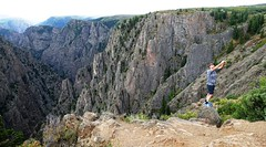 Daredevil at the Black Canyon of the Gunnison National Park (lhboudreau) Tags: outdoors outdoor landscape landscapes southrim colorado usa rimdrive rimdriveroad blackcanyon gunnison blackcanyonofthegunnison westerncolorado park nationalpark blackcanyonofthegunnisonnationalpark canyon canyons stone stones cliff cliffs rock rocks chasm crag blackrock blackrocks person daredevil rockformations rockformation gorge