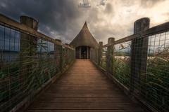 Llangorse Lake Hut (rach_brown1989) Tags: lake wizard hat hut moody light dramatic symmetry walkway wales welsh uk britain unitedkingdom evening sky clouds architecture llangorse bbcwalesnature brecon beacons