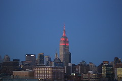 The Empire State Building is lit red in honor of the Fifth Annual Women's Health RUN 10 FEED 10. (apardavila) Tags: chryslerbuilding empirestatebuilding hoboken manhattan moon newyorkcity nyc skyline skyscraper