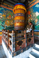 Prayer Wheel (whitworth images) Tags: painted administration building buddhist large himalaya person himalayas gho intricate bhutan enormous culture man buddhism interior travel decorated custom bhutanese ancient yellow worship wheel historic pray inside dzong turn trongsadzong asia fortress stone monastery red rotate government male robe religious religion mantra huge prayerwheel old architecture trongsa shawl dzongkha prayer traditional