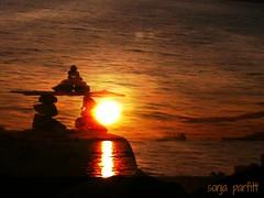 rock sculpture (Sonja Parfitt) Tags: rocksculpture englishbay sunset water boat manipulated layered