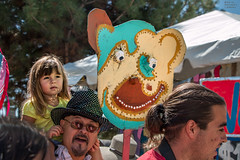 Earlobes for Ballast (Facundity) Tags: offcenterfolkartfestival albuquerque albuquirky newmexico robinsonpark folkart costumeparade canoneos70d crowd mask bear whimsy naturallight streetphotography candid bonnet outdoors creativeart upcycled puppet rimlight