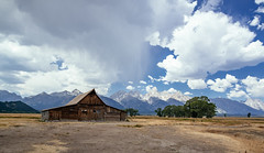 t.a. moulton barn (almostsummersky) Tags: log window grovont mormon homestead trees summer mormonrowhistoricdistrict grandtetons mountainrange weathered jacksonhole farm valley wood building wooden nationalpark mountains grandtetonnationalpark dirt clouds tamoultonbarn barn gablewithshed abandoned shower rain settlement tamoultonhomestead mormonrow afternoon grosventre antelopeflats plain tetonrange sky wyoming