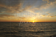 Sunset over water (Nicholas Duell) Tags: cloud coastal landscape sun sunlight sunsetsunrise water melbourne victoria australia