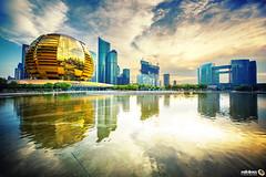Gold (Andy Brandl (PhotonMix.com)) Tags: china hangzhou architecture nikon 1424 photonmix hdr processing pool water reflections modernarchitecture cityscape urban globe intercontinental sky clouds zhejiang jianggan