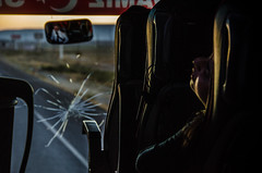 Not awake yet (Melissa Maples) Tags: aksaray turkey trkiye asia  nikon d5100   nikkor afs 18200mm f3556g 18200mmf3556g vr dawn morning window coach bus windscreen windshield cracked cracks driver reflection mirror sleeping asleep woman trkiye