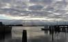 Bivalve, NJ (elisecavicchi) Tags: glow shaft sunlight beam drama clouds break rainstorm reflection water surface shore coast bivalve fishing village boat ship sky autumn fall pilings sea harbor docks