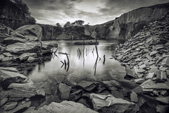 Dali's Hole (Ffotograffiaeth Dylan Arnold Photography) Tags: sincjuliet mono pool quarry dinorwig blackwhite slate wideangle snowdonia trees still calm moody reflections sheen polariser clouds sky quarrypool abandoned derelict disused hole dalishole serene cool movement tones