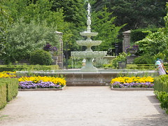 Child and Fountain, Hendrie Park, Royal Botanical Gardens, Burlington, Ontario (JP Newell) Tags: fountain water garden rbg park burlington ontario hamilton canada royal botanical gardens hendriepark feature plants flowers child summer yellow blue gate walk path
