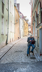 one man in Tallinn (@AvailableLights) Tags: nikon d610 24120mm tallinn estonia travel streetphotography candidphotography candid street pastel road man old sitting quiet city availablelights available light availablelight