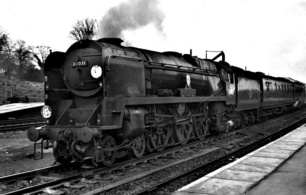 "Railways - West Country 34031 ""Torrington"" takes water at Basingstoke while  heading a down"