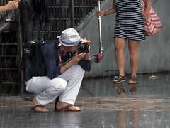 Photographer In The Rain (Multielvi) Tags: new york city nyc ny manhattan whitehall ferry terminal staten island rain storm candid street man camera photographer