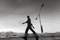 ... (_MaK_) Tags: street reflection silhouette monochrome bw people water lamppost walk bangladesh