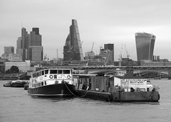 London and the City from The Thames (surreyblonde) Tags: london thames riverthames river water tide boats ships tidal portoflondon vessel floating canon g15 city londonskyline vessels tower42 natwesttower gherkin skytower walkietalkie cheesegrater bridge bw blackandwhite monochrome grey