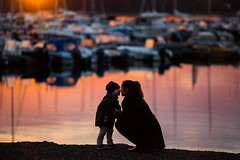 Changing noses II [explore] (JuNu_photography) Tags: changing noses ef135mmf2l 135mm 5d3 5d mark iii ef l f2 silhouette mother child love figure ground water sea boat dock harbor reflection photooftheday fun joy maternity bond journey portrait portraiture