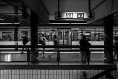 S1 S3 / ... and life never stops ... (zgr Grgey) Tags: 2016 20mm bw d750 darkcity hamburg jungfernstieg nikon s1 s3 voigtlnder blur motion station street subway germany
