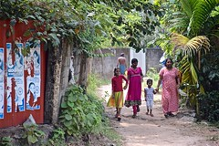 Small Town India (The Spirit of the World) Tags: southernindia india village smalltown path children locals life dailylife palms nature family walking