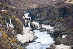 winter's residues hiding in a river canyon - HTT! (lunaryuna) Tags: iceland centraliceland landscape rivercanyon intothehighlands river canyon rockface textures shrubs spring season seasonalchange remainsofwinter oldsnow lunaryuna texturaltuesday