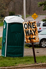 One way (bill.d) Tags: green sign yellow bathroom us spring michigan unitedstatesofamerica rusty toilet oneway outhouse leaning deadend portopotty portojohn vermontville eatoncounty eos60d vermontvillemaplesyrupfestival