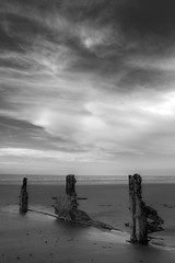 Recede (Julian Pett) Tags: uk blue england sky bw sun white seascape beach water monochrome clouds bristol sand long exposure waves break wave somerset anchor waters groyne hdr defence groin breakwater groynes minehead breakwaters bklack mygearandme