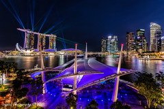 Merry Night (t3cnica) Tags: show city bridge blue light rooftop architecture marina bay landscapes singapore long exposure terrace hour esplanade laser sands theatres