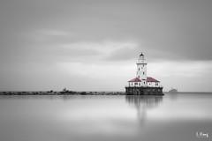 Lighthouse on the lake (lhongfoto) Tags: lake reflection lighthouse architecture black white long exposure harbor fine art michigan chicago illinois navy pier united states bw